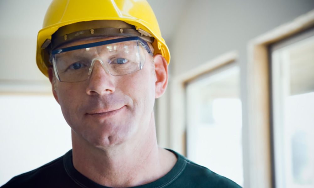 Construction Worker in Hard Hat and Safety Glasses